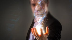 close up of Businessman holding glowing DNA helix with energy sparks.